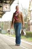 Portrait of a beautiful woman smiling on train station platform Stock Photography