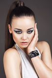 Portrait of beautiful woman with smokey eyes makeup Stock Photography