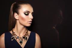 Portrait of beautiful woman with smokey eyes makeup Stock Image