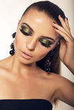 Portrait of beautiful woman with smokey eyes makeup Royalty Free Stock Photography
