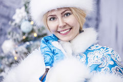 Portrait of a beautiful woman snow maiden close up in winter clo Royalty Free Stock Photography