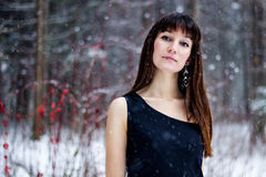 Portrait of beautiful woman in snow winter forest Royalty Free Stock Images