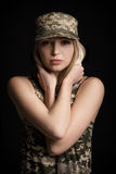 Portrait of beautiful woman soldiers in military attire on black background. sadness and despair Royalty Free Stock Images