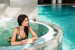 Portrait of beautiful woman in spa jacuzzi royalty free stock photos