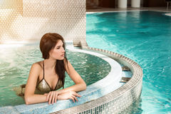 Portrait of beautiful woman in spa jacuzzi Stock Images