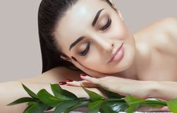 Portrait of a beautiful woman in a spa salon in front of a beauty treatment. stock photo