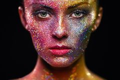 Portrait of beautiful woman with sparkles on her face stock photos