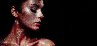 Portrait of beautiful woman with sparkles on her face stock image
