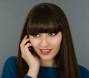 Portrait of a beautiful woman speaking by phone mobile isolated Stock Photography