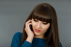 Portrait of a beautiful woman speaking by phone mobile isolated Royalty Free Stock Photo