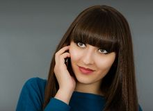 Portrait of a beautiful woman speaking by phone mobile isolated Royalty Free Stock Image