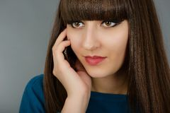 Portrait of a beautiful woman speaking by phone mobile isolated Stock Photos