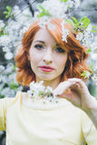 Portrait of beautiful woman in spring blooming garden stock photos