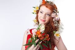 Portrait of beautiful woman with spring flowers Royalty Free Stock Images