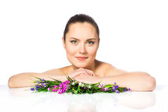 Portrait of beautiful woman in spring flowers Royalty Free Stock Photos