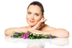 Portrait of beautiful woman in spring flowers Stock Photography