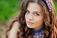 Portrait of a beautiful woman in a spring park Royalty Free Stock Photo