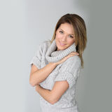 Portrait of beautiful woman standing on grey background Royalty Free Stock Photography