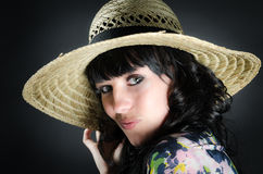 Portrait of beautiful woman with straw hat Royalty Free Stock Image