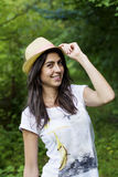 Portrait of beautiful woman with straw hat in the mountain Royalty Free Stock Image