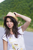 Portrait of beautiful woman with straw hat Stock Images