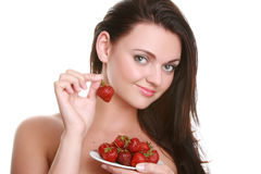 Portrait of a beautiful woman with strawberry Stock Photo