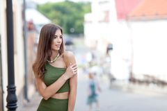 Portrait of a beautiful woman on a street walk. In the youth style royalty free stock image