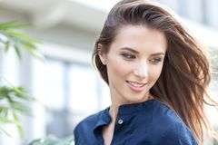 Portrait of a beautiful woman on a street walk. In the youth style royalty free stock photography