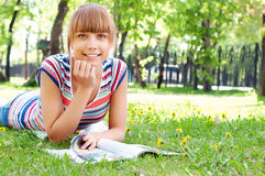 Portrait of a beautiful woman in summer park Royalty Free Stock Image