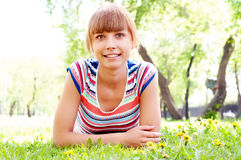 Portrait of a beautiful woman in summer park Stock Images