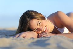 Portrait of a Beautiful woman sunbathing lying on the beach Stock Photography