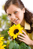 Portrait of beautiful woman with sunflowers Stock Images