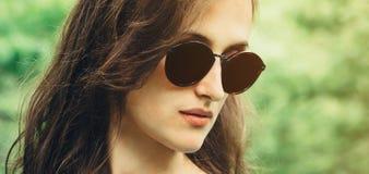Portrait of beautiful woman in sunglasses Stock Photos