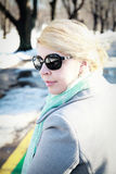 Portrait of beautiful woman with sunglasses on winter outdoor background Royalty Free Stock Photo