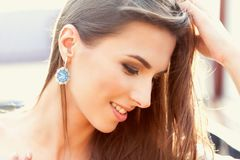 Portrait of a beautiful woman in sunny weather. stock photography