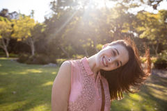 Portrait of beautiful woman swaying her hair in the park Stock Image
