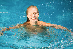 Portrait of beautiful woman swimming in swimming pool Royalty Free Stock Photos