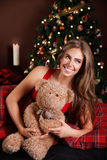 Portrait of a beautiful woman with a teddy bear Stock Photos
