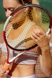 Portrait of beautiful woman with tennis rocket outdoor. Summer Sport recreation. royalty free stock photos