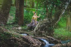Portrait of Beautiful woman in Thai Traditional dress, Kinnara I Stock Photo