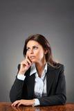 Portrait of a beautiful woman thoughtful Royalty Free Stock Image