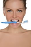 Portrait beautiful woman with toothbrush in teeth. Portrait of beautiful woman with toothbrush in his teeth isolated on white Stock Images