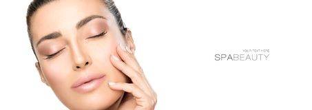 Portrait of beautiful woman touching her face. Beauty and skincare concept royalty free stock image