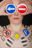 Portrait of beautiful woman with traffic signs Royalty Free Stock Image