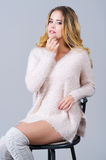 Portrait of a beautiful woman in trandy knitted clothes Stock Photos