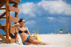 Portrait of a beautiful woman on a tropical beach. Royalty Free Stock Image