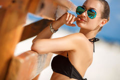 Portrait of a beautiful woman on a tropical beach. Royalty Free Stock Images