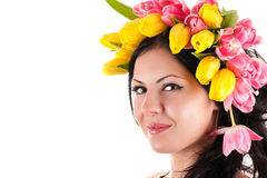 Portrait of a beautiful woman with tulips on the head Stock Image
