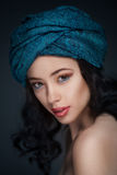 Portrait of a beautiful woman in turban Stock Photography