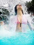 Portrait of beautiful woman under splash water Stock Images